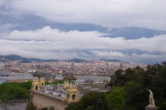 Cloudy Barcelona. Cloudy endless Barcelona skyline merges to mountains stock image