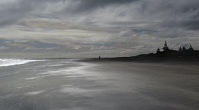 Cloudy beach Stock Images