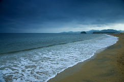 Cloudy beach Stock Photography