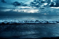 Cloudy beach background at night. Cloudy beach backgrounds at night royalty free stock images