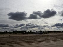 Cloudy beach. Enjoying a beautiful cloudy sky at Royalty Free Stock Images