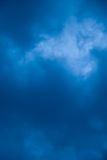 Cloudy Blue Background. A photograph of a cloudy stormy sky, frame-filled to make an interested background texture Royalty Free Stock Photos