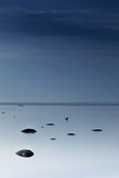 Cloudy blue minimalist seascape. Deserted space. Horizon line. Stock Photography