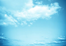 Cloudy blue skies Stock Image