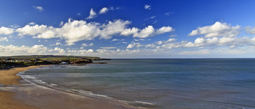 Cloudy Blue Skies over North Bay Scarborough. Wispy white clouds across Blue Skies over North Bay Scarborough, North Yorkshire Stock Photography