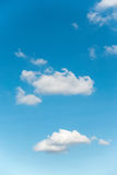 Cloudy and blue skies on sunny day. Stock Images