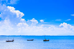 Cloudy blue sky above a Fishing boat Stock Photo