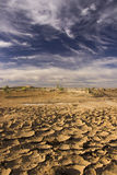 Cloudy Blue Sky Above Parched Barren Land In Morocco Royalty Free Stock Photo