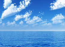 Cloudy blue sky above the sea Stock Photo