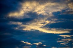 Cloudy blue sky in the afternoon sun Royalty Free Stock Image