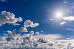 Cloudy Blue Sky as Background. Direct Sunlight, Sun Above the Cl Stock Images