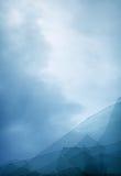 Cloudy blue sky through broken window Royalty Free Stock Photos