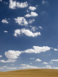 Cloudy blue sky in countryside. Royalty Free Stock Photos