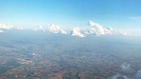 Cloudy blue sky on flight view from the window. View from plane window look out cloudy day blue sky floating fluffy clouds skyline stock footage