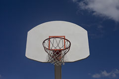 Cloudy blue sky frames retro basketball goal. Royalty Free Stock Photos