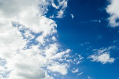 Cloudy blue sky with gray clouds, nature background with blue texture and shapes of clouds. royalty free stock photo