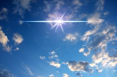 Cloudy blue sky with magic mystic star flare stock image