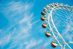 Cloudy Blue Sky over Ferris Wheel Stock Images