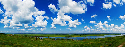 cloudy blue sky over gently rolling patchwork farmland Royalty Free Stock Photography