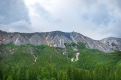 Cloudy blue sky over the rocks. Siberia landscape Royalty Free Stock Photo