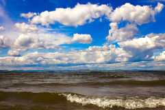 Cloudy blue sky over the sea Stock Image