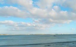 Cloudy blue sky over the sea. Of Mandriola Sardinia - Italy -Background of rocky stacks and beach Royalty Free Stock Photography