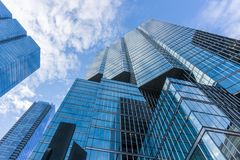 Cloudy blue sky reflection skyscraper glass exterior stock photography