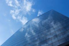 Cloudy blue sky reflection skyscraper glass exterior trees frami Stock Photography