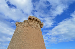 Cloudy Blue Sky And Stone Tower Suitable For A Background Or Backdrop Stock Photos