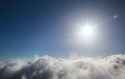Cloudy blue sky and sun Stock Photography