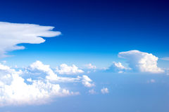 Cloudy blue sky view from aircraft Stock Photos