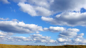 Cloudy Blue Sky. View of Blue Sky and White Clouds Royalty Free Stock Image