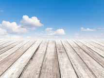 Cloudy blue sky and wood floor Stock Photos