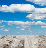 Cloudy blue sky and wood floor Royalty Free Stock Images