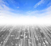 Cloudy blue sky and wood floor. Royalty Free Stock Photography