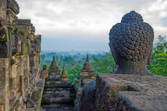 Cloudy Borobudur. Meeting sunrise buddha in Borobudur Royalty Free Stock Image
