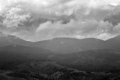 Cloudy Carpathian mountains landscape. Chornogora ridge, black and white photo. Royalty Free Stock Photo