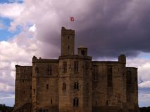 Cloudy castle. Landscape shot of English castle in partial ruin on a cloudy sunny day with central dramatic Stock Photo