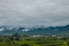 Cloudy clouds over city. A dark cloudy sky over a city stock image