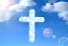 Cloudy cross. On a blue sky Royalty Free Stock Photography