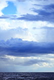 Cloudy dark sky above a surface of the sea Royalty Free Stock Images