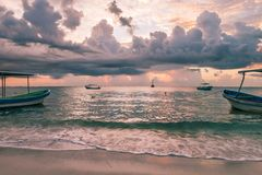Cloudy Dawn over Diving Boats in the Caribbean Sea, Mexico royalty free stock images
