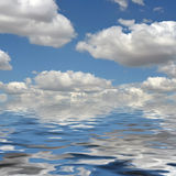 Cloudy day. Beautiful clouds are reflected in water Royalty Free Stock Image