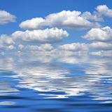Cloudy day. Beautiful clouds are reflected in water Royalty Free Stock Photography