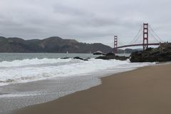 Cloudy day on the Beach looking at the Golden Gate Bridge stock image