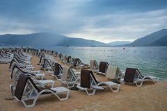 Cloudy day on the beach. Montenegro, view of Bay of Kotor near Tivat city. Cloudy day on the beach. Montenegro, Adriatic Sea, view of Bay of Kotor near Tivat stock image