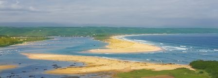 Cloudy day on the beach at Plettenberg Bay stock photos
