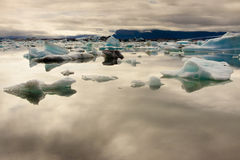 Cloudy day, blue ice lake Jokulsarlon - Iceland Royalty Free Stock Photo