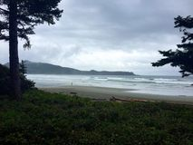 Cloudy day on Cox Bay, Tofino, British Columbia, Canada Stock Photo