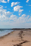 Cloudy day at Glenelg Beach in South Australia as seen from pier Stock Images